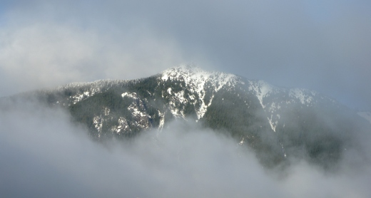 Clouds and rain, the mountain mostly hidden throughout the day, showing its face in brief glimpses.