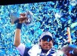 Quarter back Russell Wilson hoists the trophy