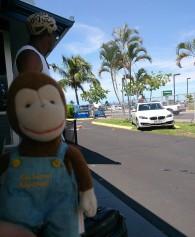 George returning his rental car at the airport