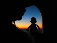 George and Marion watching the sunset from the plane